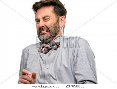 Middle age man, with beard and bow tie disgusted and angry, keeping hands in stop gesture, as a defense, shouting isolated over white background