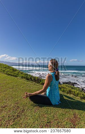 Woman Meditating On The Scenic Maui Coast