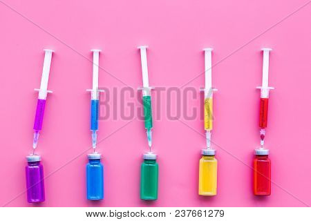 Vaccination, Immunization. Syringe And Bottle With Medicament On Pink Background Top View.