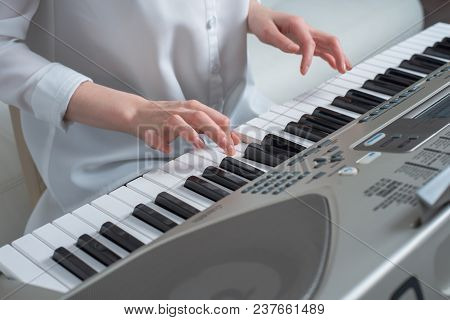 The Concept Of Composing Melodies, Hands Playing The Synthesizer.