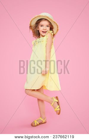 Expressive Charming Girl In Yellow Dress And Sandals Shouting On Pink Background.