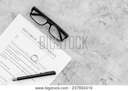 Divorce Agreement. Wedding Ring On Document On Grey Background Top View.