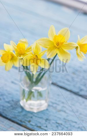 A Bouquet Of Yellow Narcissus In The Glass Vase