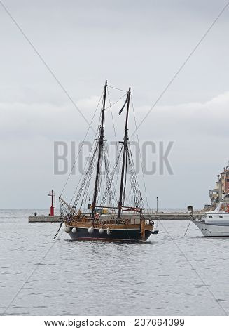 Old Wooden Sail Ship With Two Masts In Port
