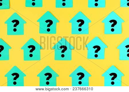 Stickers In The Form Of Houses On A Bright Yellow Background. On The Turquoise Sticky Notes A Questi