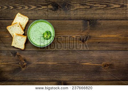 Natural, Organic Food. Green Vegetable Soup-puree In Bowl Ready To Eat Served With Rusks On Dark Woo