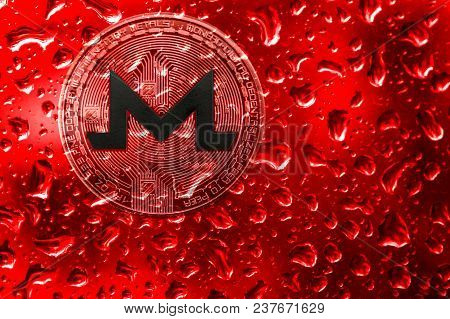Coin Monero Behind Glass With Red Drops. Blood On Bitcoin. Terrorism, War, Extortion, Crimes For Mon