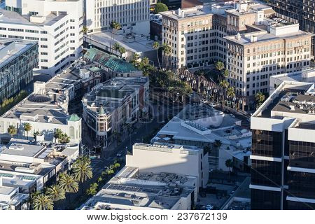 Aerial view of Rodeo Drive at Wilshire Blvd in heart of Beverly Hills upscale shopping district near Los Angeles, California.