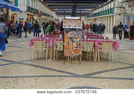 Lisbon - April 01 , 2018 : Rua Augusta Street In The Evening, Shops, Tourists, Cafes And Restaurants