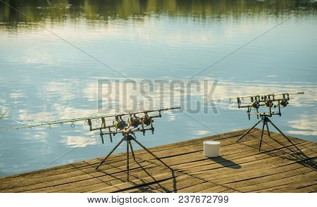 Fishing Tackles On Pod On Wooden Pier. Fishing, Spin Fishing, Angling, Catching Fish, Adventure, Spo