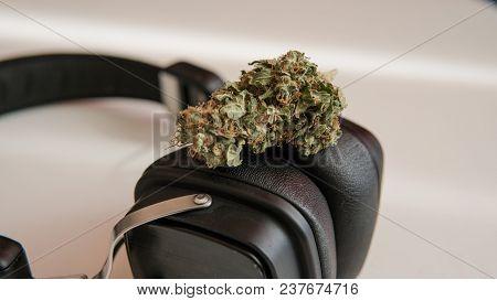 Medical Marijuana Lying On Headphones On A White Background.