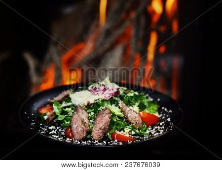 Dish Of Beef Or Veal Served With Lettuce Leaves, Tomatoes And Sprinkled With Parmesan Cheese, Fire O