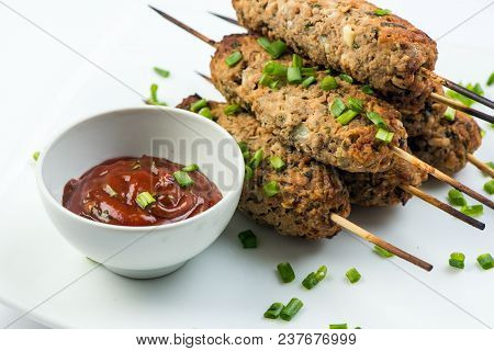 Kebab Lula With Herbs On White Plate On White Background With Ketchup