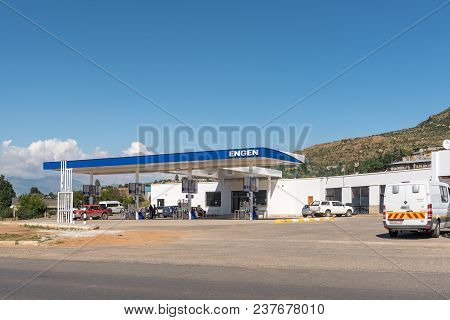 Qwaqwa, South Africa - March 14, 2018: A Street Scene With Gas Station And Vehicles In Phuthaditjhab