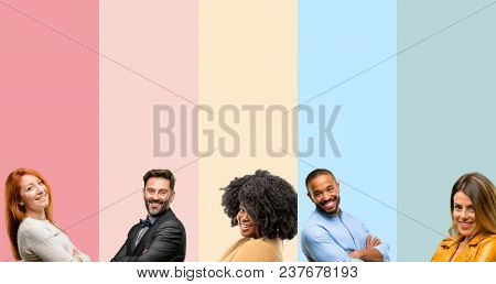 Cool group of people, woman and man with crossed arms confident and happy with a big natural smile laughing