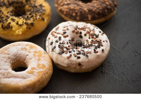 Assorted donuts with chocolate, glaze and sprinkles