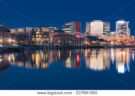 Wilmington, De - April 5, 2018: Wilmington, Delaware Night Skyline And Riverwalk  Along The Christia