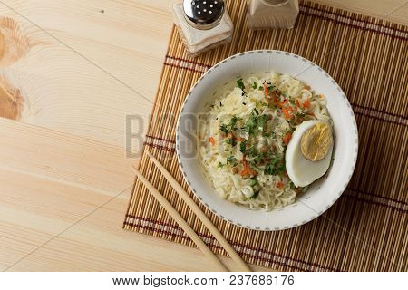 Instant Noodles In Bowl, Asian Cheap Fast Food On Wooden Table, Top View