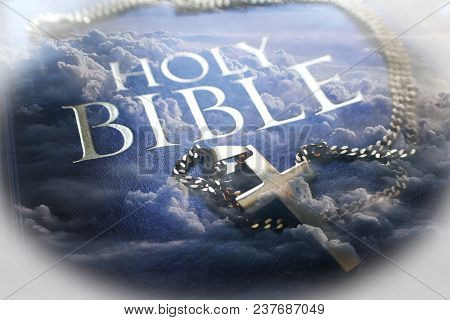 Holy Bible With Gold Cross & Clouds High Quality Stock Photo
