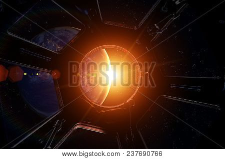 Earth And Sun. Sunrise From Spaceship International Space Station Window. Elements Of This Image Fur