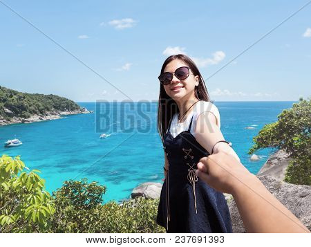 Smiling Asian Cute Girl Pulling Her Friend Hand Over Summer Beach Background. Teenager Tourist Enjoy