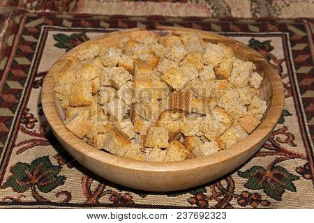 Rusk Squares Made Of Wheat Sourdough Bread In A Wooden Bowl Stand On A Table On A Colored Homemade N