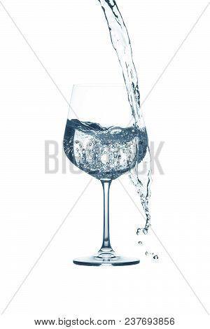 Red Wine Splashing Out Of A Glass, Isolated On White.