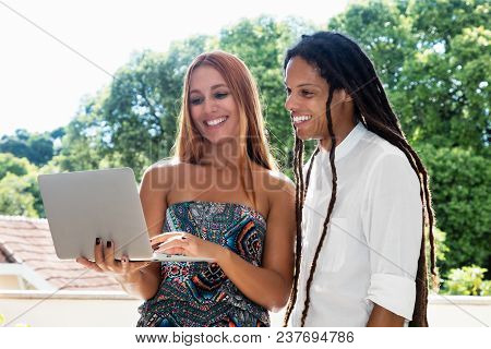 Female Student And Friend Looking At Computer