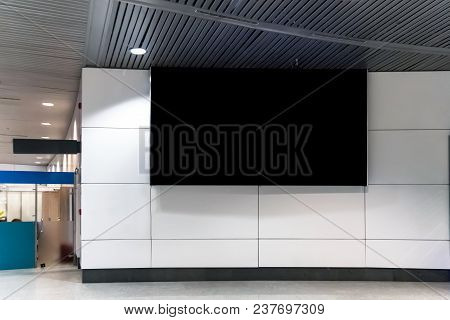 Billboard Or Advertising Poster In The Airport For Advertisement Concept Background. A Large Black S
