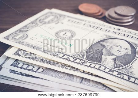 Selective Focus Money Banknotes Us Dollar And Coins On Background Put On Wooden Table, Vintage Style