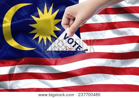 Malaysia General Election Concept. Close Up Hand Of A Person Casting A Ballot At Elections During Vo