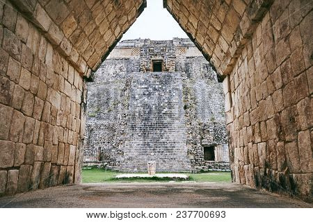 The Pyramid Of Magician View From The Gate Of Nunnery, The Ancient Of Mayan Ruins In Uxmal, Yucatan,