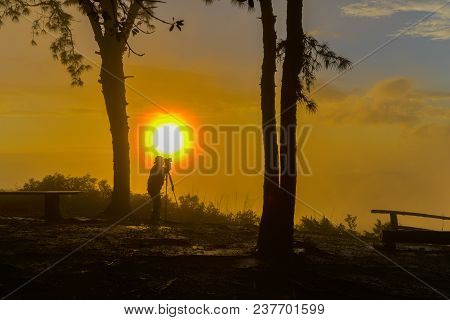 Un-identified Photographer Shooting Photo Of Beautiful Sunrise View In National Park Of Thailand
