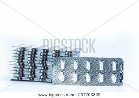 Stacks Of Anti Allergy Pills In Blister Packs Isolated On White Background. Pharmaceutical Market. C