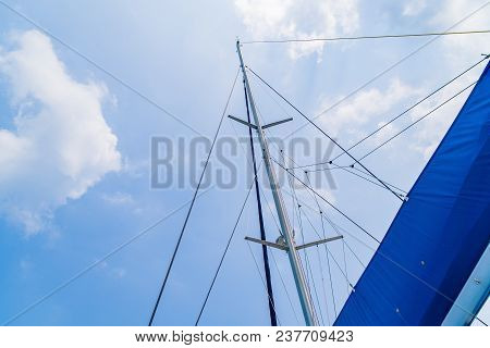 Sails Of Sailing Yacht In The Wind, In Yacht On Blue Sky Sunset Light Background, Vacation Holidays