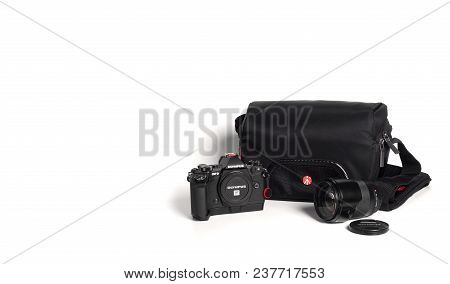Bangkok, Thailand - April 25, 2018 : Mirrorless Camera With Lens And Camera Bag Isolated On White Ba