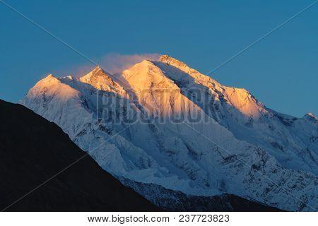 Mountain Peak With First Sunlight During Sunrise On Top In The Morning. Rakaposhi Mountain Peaks In