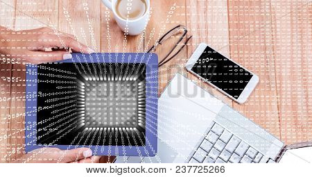 Digital composite of Businesswoman holding digital tablet at desk with overlay