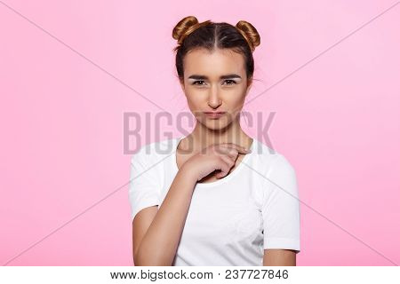Portrait Of Beautiful Calm Pensive Woman On Pink Background
