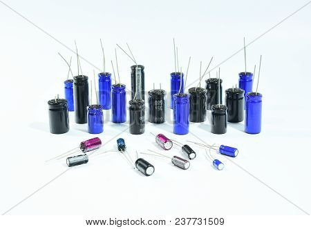 Electrolytic Capacitors, Multi Color And Many Sizes, Isolated On White Background, Electronics Part