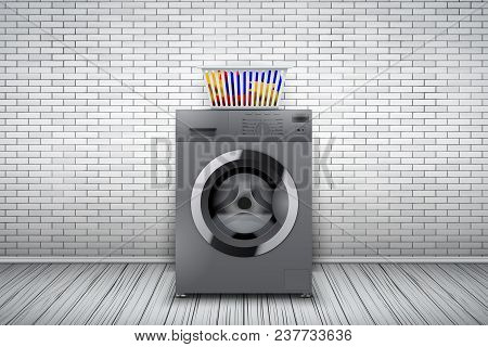 Laundry Room Interior With Silver Washing Machine And Basket On White Brick Wall Background. The Con