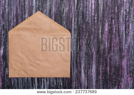Envelope Of Kraft Paper. Love Letter Envelope. Wooden Background. Social Network.