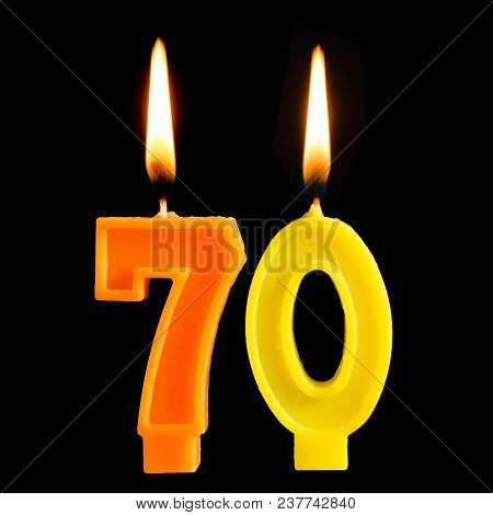 Burning Birthday Candles In The Form Of 70 Seventy Figures For Cake Isolated On Black Background. Th