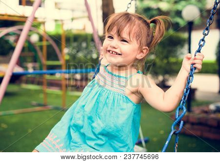 Little girl having fun playing in the park