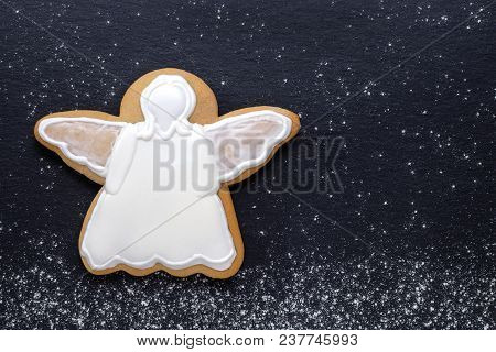 White Angel Gingerbread On Black Background, Copy Space