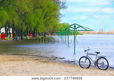 Chernihiv / Ukraine 20 April 2018: Lonely Bicycle Standing On Beach During Flooding On City Beach. E