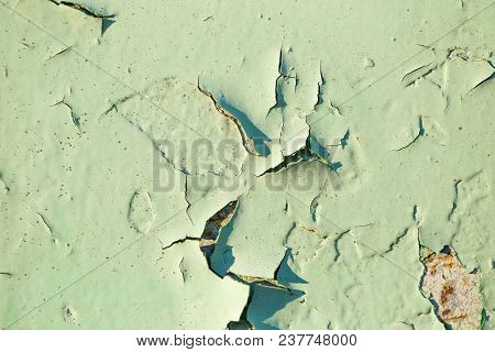 Irradiated Green Paint On Rusty Iron Closeup