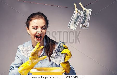 Conceptual Picture On Which The Woman Launder Shady Money