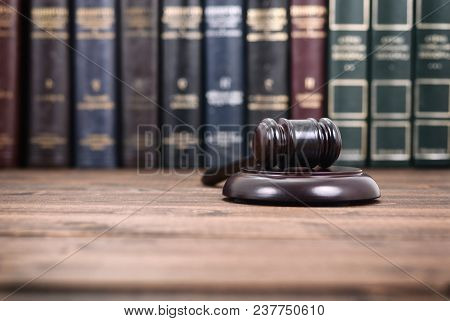 Law And Justice, Legality Concept, Judge Gavel On A Black Wooden Background In Front Of Law Library.