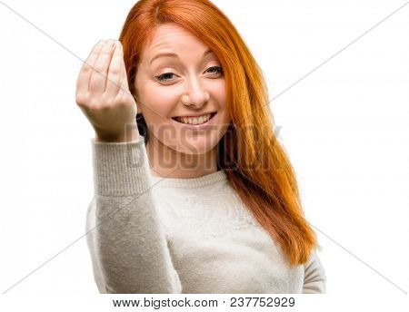 Beautiful young redhead woman angry gesturing typical italian gesture with hand, looking to camera isolated over white background